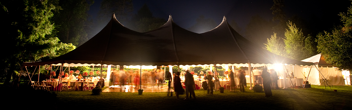 Wedding event at nighttime under a canopy